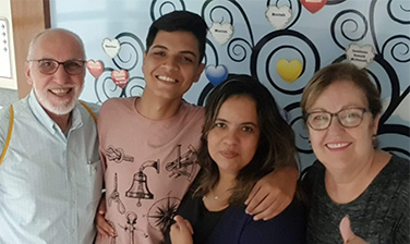 An RMHC family, the de Araujo Moeiras, Juan Carlos at 18 years old in left-center, surrounded by three family members